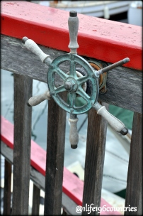 boat steering wheel on fence