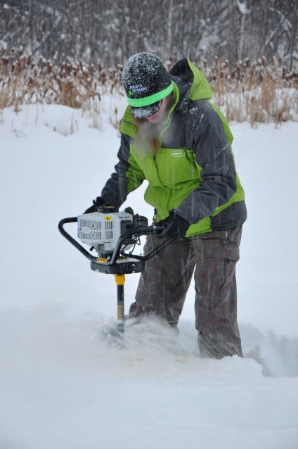 Boring an ice-fishing hole on Radar Lake (Bear Mountain) #DawsonCreekBC